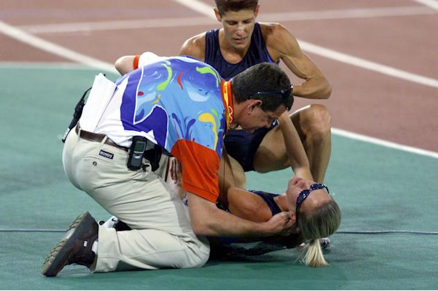 30 Sep 2000: Suzy Favor Hamilton of the USA is attended to by a doctor and team mate Marla Runyan after a fall, in the final of the Women's 1500m at the Sydney 2000 Olympic Games, held at Stadium Aust