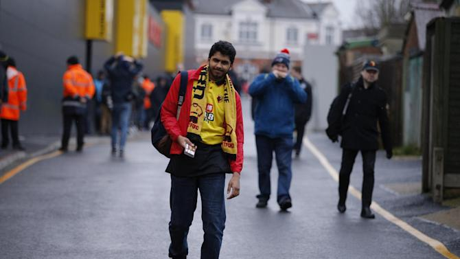 Watford fan outside the stadium before the match