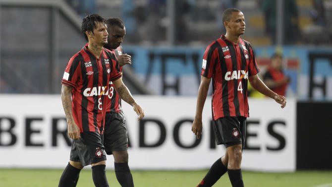 Brazil's Atletico Paranaense players leave the pitch at the end of their Copa Libertadores soccer match against Peru's Sporting Cristal in Lima, Peru, Wednesday, Jan. 29, 2014. Peru's Sporting Cristal won the match 2-1