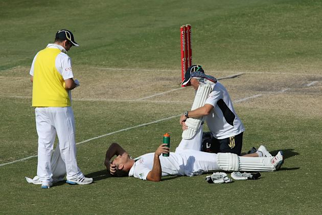 ADELAIDE, AUSTRALIA - NOVEMBER 26: Faf du Plessis of South Africa receives treatment in the last few overs of the day during day five of the Second Test Match between Australia and South Africa at Ade