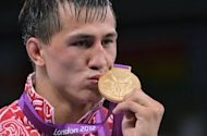 Russian gold medalist Roman Vlasov kisses his medal as he poses on the podium of the 74kg Greco Roman Wrestling Final match of the London 2012 Olympic Games at the Excel Centre in London