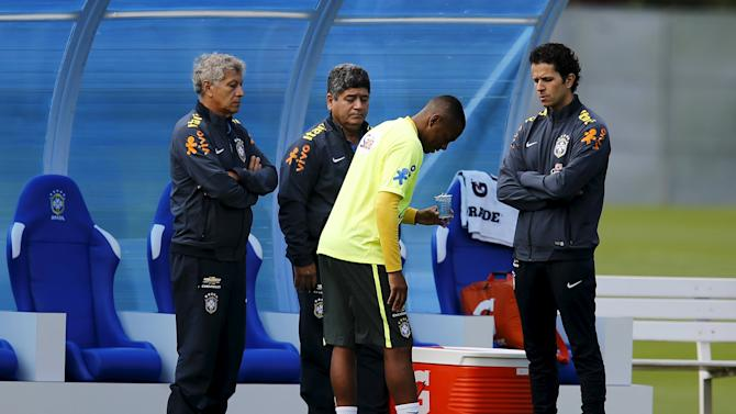 Brazilian national soccer team player Robinho talks with doctor Lasmar during a training session in Teresopolis