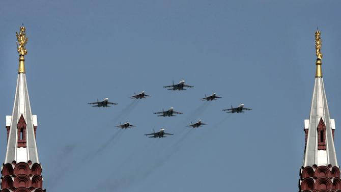 Russian MIG-29 and SU-27 fighter jets fly over Red Square during a Victory Day Parade in Moscow on May 9, 2008