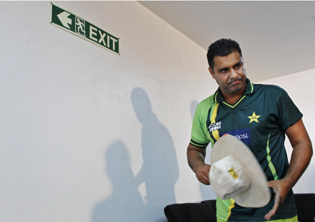 Pakistan's cricket coach Waqar Younis leaves a news conference prior to a practice session in Hambantota, Sri Lanka, Monday, Feb. 21, 2011. Pakistan will face Kenya in a Cricket World Cup match on Wed