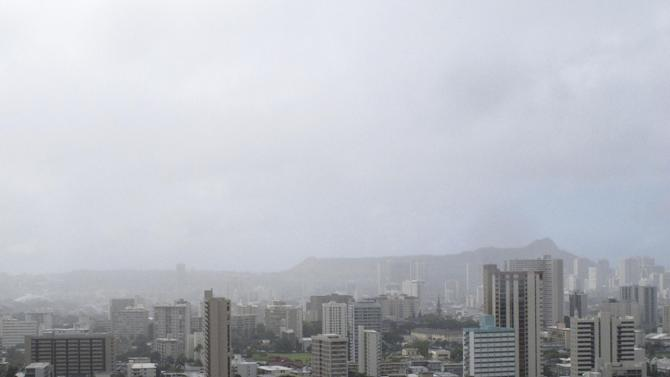 Diamond Head is shrouded in clouds in Honolulu as Tropical Storm Flossie approaches Hawaii on Monday, July 29, 2013. A tropical storm making its way toward Hawaii had residents of Maui and the Big Island on Monday bracing for possible flooding, 60 mph wind gusts and waves that could reach as high as 18 feet. Tropical Storm Flossie could also bring mudslides, tornadoes and waterspouts, forecasters said. (AP Photo/Audrey McAvoy)