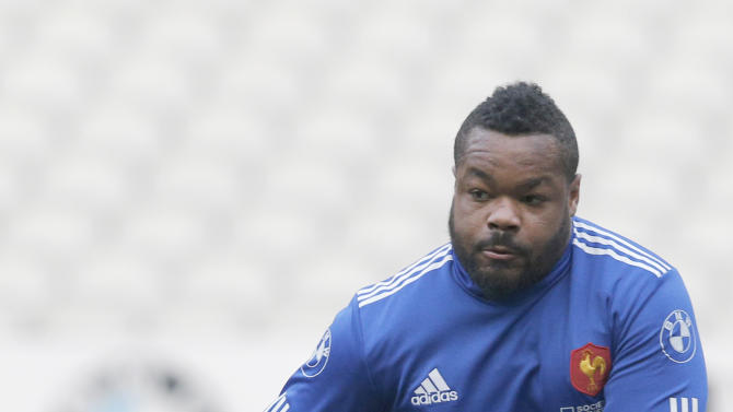 France's Mathieu Bastareaud gives the ball during a training session at the stade de France stadium, in Saint Denis, outside Paris, Friday, March 14, 2014. France will play Ireland during a Six Nations Rugby Union match on March 15. (AP Photo/Christophe Ena)