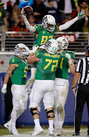 SANTA CLARA, CA - DECEMBER 05:  Andre Yruretagoyena #72 of the Oregon Ducks and Darren Carrington #87 of the Oregon Ducks celebrate a third quarter touchdown against the Arizona Wildcats during the PAC-12 Championships at Levi's Stadium on December 5, 2014 in Santa Clara, California.  (Photo by Brian Bahr/Getty Images)
