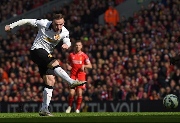 Manchester United's English Wayne Rooney has an unsuccessful shot during the English Premier League match against Liverpool at Anfield in Liverpool, north west England on March 22, 2015