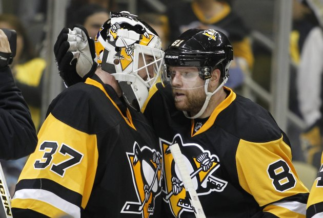 PITTSBURGH, PA - APRIL 13:  Jeff Zatkoff #37 of the Pittsburgh Penguins and Phil Kessel #81 celebrate after defeating the New York Rangers 5-2 in Game One of the Eastern Conference Quarterfinals during the 2016 NHL Stanley Cup Playoffs at Consol Energy Center on April 13, 2016 in Pittsburgh, Pennsylvania.  (Photo by Justin K. Aller/Getty Images)