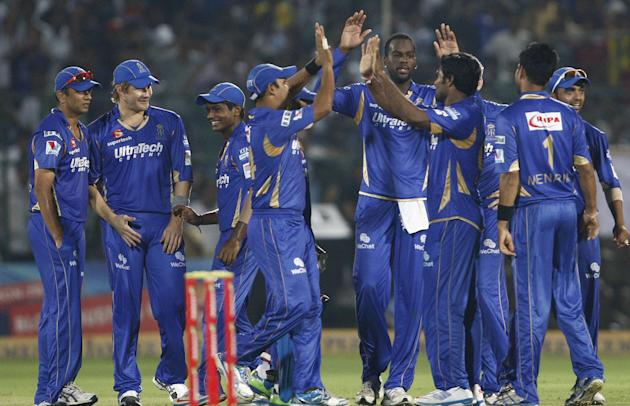 Rajasthan Royals players celebrate fall of wicket during the CLT20 1st Semi-Final between Rajasthan Royals and Chennai Super Kings at Sawai Mansingh Stadium in Jaipur on Oct. 4, 2013.
