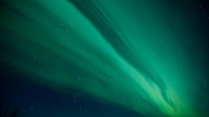 FILE - This Jan. 23, 2012 file photo shows the aurora borealis, or Northern Lights, near the city of Talkeetna, Alaska. This year and next year are expected to offer prime viewing for the northern lights due to a peak in the cycle of solar activity that causes the lights. The Fairbanks region of Alaska is gearing up for increased tourism as visitors flock to see the colorful but elusive phenomenon.  (AP Photo/Michael Dinneen, file)