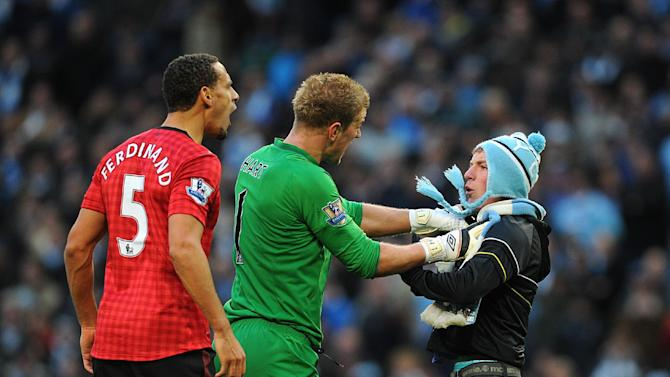 The fan who tried to confront Rio Ferdinand, left, on the pitch could face a lifetime ban