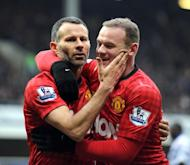 Ryan Giggs (L) celebrates scoring Manchester United's second goal against QPR with Wayne Rooney, on February 23, 2013. The evergreen Giggs sealed victory in the 80th minute, ghosting onto Nani's through ball and whipping a low shot past the exposed Cesar