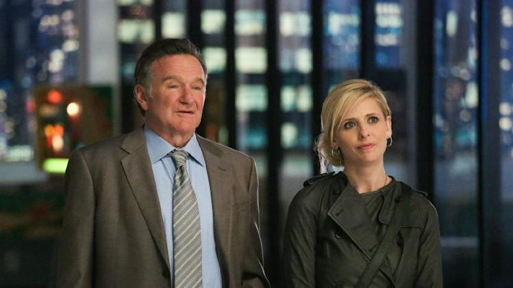 "This publicity image released by CBS shows Robin Williams, left, and Sarah Michelle Gellar in a scene from the pilot episode of ""The Crazy Ones,"" a new CBS comedy premiering in the fall of 2013. (AP Photo/CBS, Richard Cartwright)"
