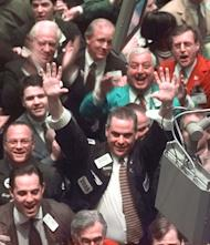 FILE - In this March 29, 1999 file photo, traders celebrate on the floor of the New York Stock Exchange after the Dow ended the day above 10,000 point for the first time in history. When it comes to Wall Street, big, round numbers make people take notice. Dow 13,000, reached earlier this week for a few brief minutes, was the latest example.(AP Photo/Adam Nadel)