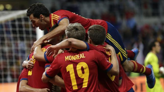 Spain's players celebrate their second goal during a friendly soccer match between Spain and Chile at the Stade de Geneve stadium, in Geneva, Switzerland, Tuesday, Sept. 10, 2013