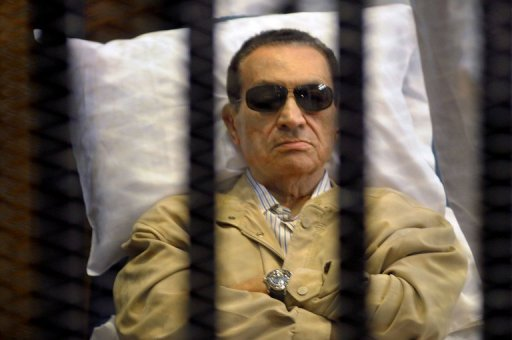 Ousted Egyptian president Hosni Mubarak sits inside a cage in a courtroom during his verdict hearing in Cairo on June 2, 2012, as he was sentenced to life in prison. The European Union announced Monday it was lifting its asset freeze on Egyptian and Tunisian funds, imposed as sanctions before the countries' strongmen rulers were ousted in the Arab Spring uprisings