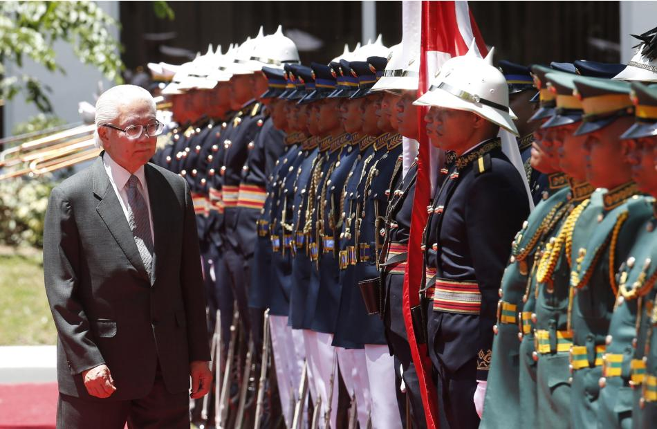 Singapore's President Tony Tan reviews an honour guard during a welcoming ceremony for him at the Malacanang presidential palace in Manila