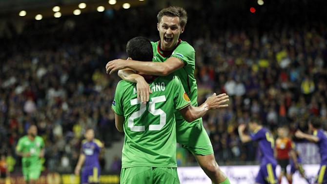 Rubin Kazan's Ivan Marcano, bottom with Aleksandr Ryazantsev, celebrates his goal against Maribor, during their group D Europa League f soccer match, in Maribor, Slovenia, Thursday, Sept. 19, 2013