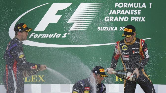 Winning drivers celebrate on podium after Japanese F1 Grand Prix at the Suzuka circuit