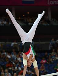 Mexico's gymnast Daniel Corral Barron performs during the men's parallel bars final of the artistic gymnastics event of the London Olympic Games on August 7, 2012 at the 02 North Greenwich Arena in London. AFP PHOTO / EMMANUEL DUNAND