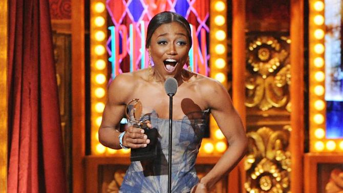 """FILE - This June 9, 2013 file photo shows Patina Miller accepting her Tony Award for best actress in a musical for her role in """"Pippin"""" at the 67th Annual Tony Awards in New York. There were smiles at many Broadway box offices last week as a big financial bounce followed the Tony Awards, with the biggest winners being """"Pippin,"""" """"Matilda the Musical"""" and """"Motown the Musical."""" Data from The Broadway League on Monday, June 17, 2013, shows exposure and statuettes on the June 9 show helped many shows have their most profitable weeks ever and break some individual theater records. (Photo by Evan Agostini/Invision/AP, File)"""