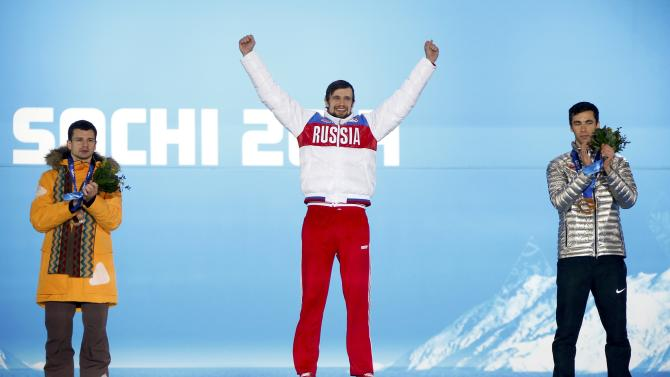 Gold medallist Tretiakov of Russia, silver medallist Dukurs of Latvia and bronze medallist Antoine of the U.S. celebrate during the victory ceremony for the men's skeleton event at the 2014 Sochi Winter Olympics in Sochi