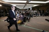 """Toshiba Corp. President Satoshi Tsunakawa arrives for a press conference at the company's headquarters in Tokyo, Tuesday, Feb. 14, 2017. Japanese electronics and energy giant Toshiba said Tuesday that its chairman is resigning to take responsibility for problems that will result in a 713 billion yen ($6.3 billion) loss in its nuclear business. Toshiba warned, however, that unaudited financial results it announced may change """"by a wide margin."""" It earlier delayed reporting its official financial results by a month, citing auditing problems related to the losses in its nuclear business. That sent Toshiba stock tumbling 8 percent in Tokyo trading. (AP Photo/Shizuo Kambayashi)"""