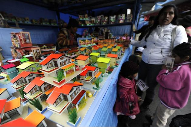 Miniature houses are seen during the Alasitas festival on January 24, 2012 in La Paz