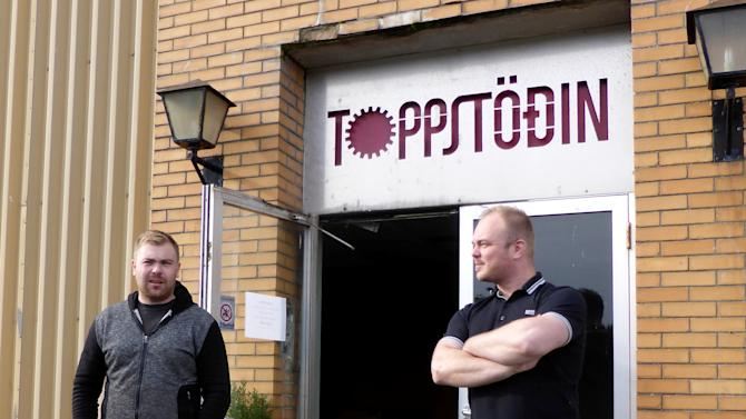 Start-up firm Icewind's founder and CEO Asgeirsson and  Chief Business Development Officer Bachmann pose for a picture in front of the company's headquarters in Reykjavik, Iceland