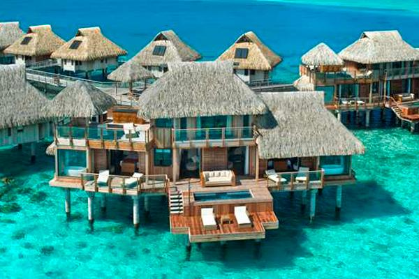 1. Presidential Suite At Hilton Bora Bora In Nui, Tahiti Overwater bungalows are du riguer in French Polynesia, but not many can boast that they have two stories and an ultra-secluded position at the edge of a long pontoon. This two-bedroom suite offers all that, plus a private pool, an outdoor Jacuzzi, a dedicated in-room spa area, two living rooms and three bathrooms. Décor is traditional Tahitian, with natural woods and tropical prints. Nothing beats a morning cannonball into the multi-blue toned water, just off your sprawling deck. For more info, visit hilton.com.