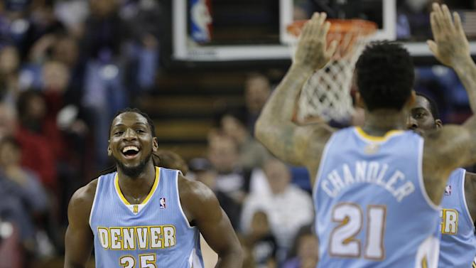 Denver Nuggets' Kenneth Faried, left, Wilson, Chanler, center, and J.J. Hickson, background right, celebrate after scoring against the Sacramento Kings during the third quarter of an NBA basketball game in Sacramento, Calif., Sunday, Jan. 26, 2014. The Nuggets won 125-117