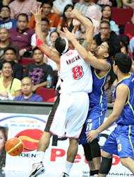 Calvin Abueva is fouled hard by Aaron Aban. (PBA Images)