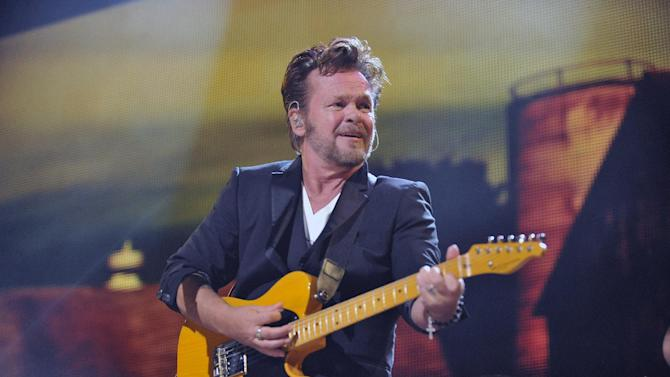 FILE - In a Saturday, Sept. 21, 2013 file photo, John Mellencamp performs during the Farm Aid 2013 concert at Saratoga Performing Arts Center in Saratoga Springs, N.Y. John Mellencamp, Madonna, and Led Zeppelin's Jimmy Page and Robert Plant are among the nominees for the 2014 Songwriters Hall of Fame. They're joined by a number of top acts, including Ray Davies, Sade, Cyndi Lauper and Linda Perry. Songwriters Hall gave The Associated Press a list of nominees in advance of the official announcement, set for Thursday, Oct. 9, 2013. The gala takes place June 12 at the New York Marriott Marquis.(AP Photo/Hans Pennink, File)