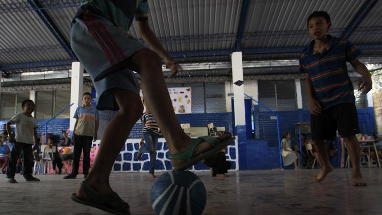 Children play soccer at a school being used as a shelter for residents evacuated from the surrounding areas of the Chaparrastique volcano in the municipality of San Miguel