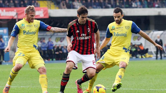 AC Milan Brazilian forward Kaka, center, is challenged by Chievo's players Luca Rigoni, left, and Ivan Radovanovic, of Serbia, during a Serie A soccer match against Chievo at Bentegodi stadium in Verona, Italy, Sunday, Nov. 10, 2013