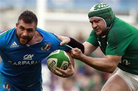 Ireland's Best challenges Italy's Barbieri in their Six Nations rugby union match at Aviva stadium in Dublin