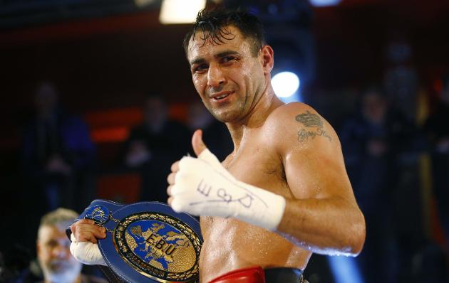 Italy's Michele Di Rocco celebrates after defeating Denmark's Kasper Bruun in their European super lightweight boxing title fight in Milan