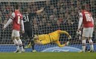 The ball slams into the back of the net past the diving Arsenal goalkeeper Wojciech Szczesny for Bayern Munich's first goal, on February 19, 2013. Goals from Toni Kroos and Thomas Mueller put the visitors 2-0 up by the 21st minute