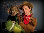Violet, the dinosaur, with her mommy, the cowgirl.