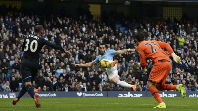 Manchester City's Negredo shoots and scores his goal during their English Premier League soccer match against Tottenham Hotspur at the Etihad Stadium in Manchester