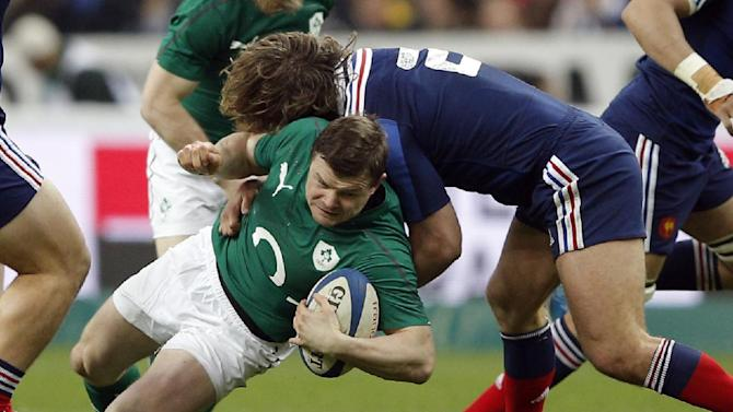 Ireland's Brian O'Driscoll is tackled by France's Dimitri Szarzewski during the Six Nations Rugby Union match between France and Ireland at the Stade de France stadium, in Saint Denis, outside Paris, Saturday, March 15, 2014