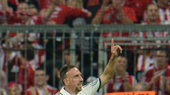 Munich's Franck Ribery of France celebrates after scoring during the German soccer cup second round match between FC Bayern Munich and Hannover 96, in Munich, southern Germany, Wednesday, Sept. 25, 2013