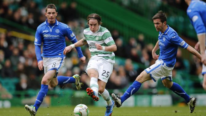 St Johnstone's McDonald and Millar challenge Celtic's Johansen during their Scottish Premier League soccer match in Glasgow