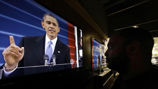 Richard Smith watches President Barack Obama deliver his inaugural address during the ceremonial swearing-in, on a television at a Best Buy department store in Springfield, Ill., Monday, Jan. 21, 2013. (AP Photo/Seth Perlman)