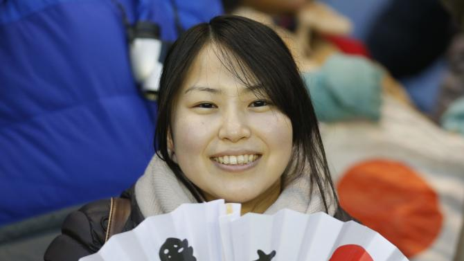 A Japanese supporter holds fans after the rugby union match against Scotland at Murrayfield Stadium in Edinburgh