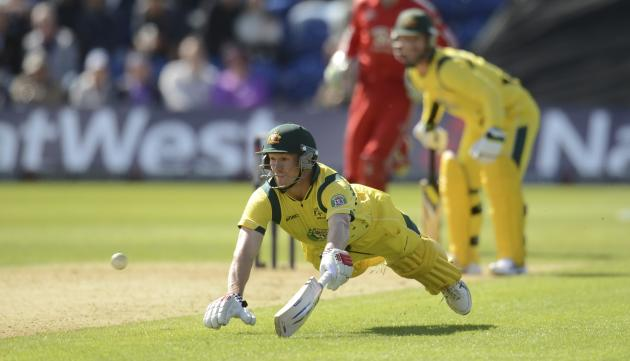 Australia's Bailey dives to get into his ground during the fourth one-day international against England at Sophia gardens in Cardiff, Wales