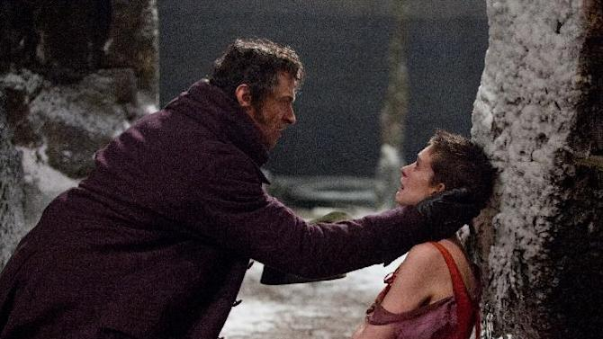 "This film image released by Universal Pictures shows Hugh Jackman as Jean Valjean, left, and Anne Hathaway as Fantine in a scene from ""Les Miserables.""  The film was nominated for a Golden Globe for best musical or comedy on Thursday, Dec. 13, 2012. The 70th annual Golden Globe Awards will be held on Jan. 13. (AP Photo/Universal Pictures)"