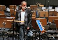 """Lebanese composer Marcel Khalife is pictured during a rehearsal with the Qatar Philharmonic Orchestra, presenting choral compositions inspired by the Arab Spring, at the Doha Opera House in the Qatari capital on February 3, 2013. The famous Lebanese composer enthralled a Qatari audience with his Arab Spring-inspired suite """"Oriental"""" in Doha"""