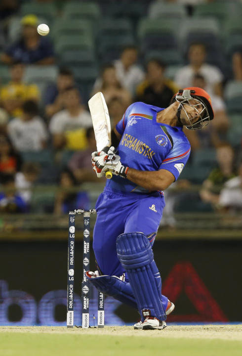 Afghanistan's Samiullah Shenwari bats during their Cricket World Cup Pool A match against Australia  in Perth, Australia, Wednesday, March 4, 2015. (AP Photo Theron Kirkman)